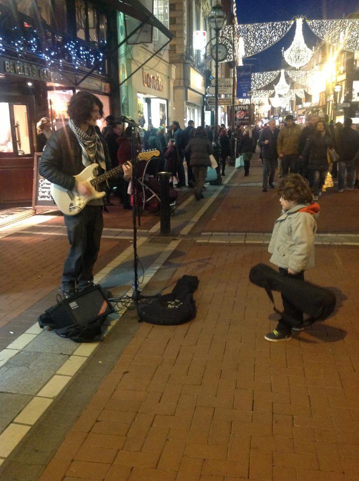boy and busker on Grafton Street Dublin